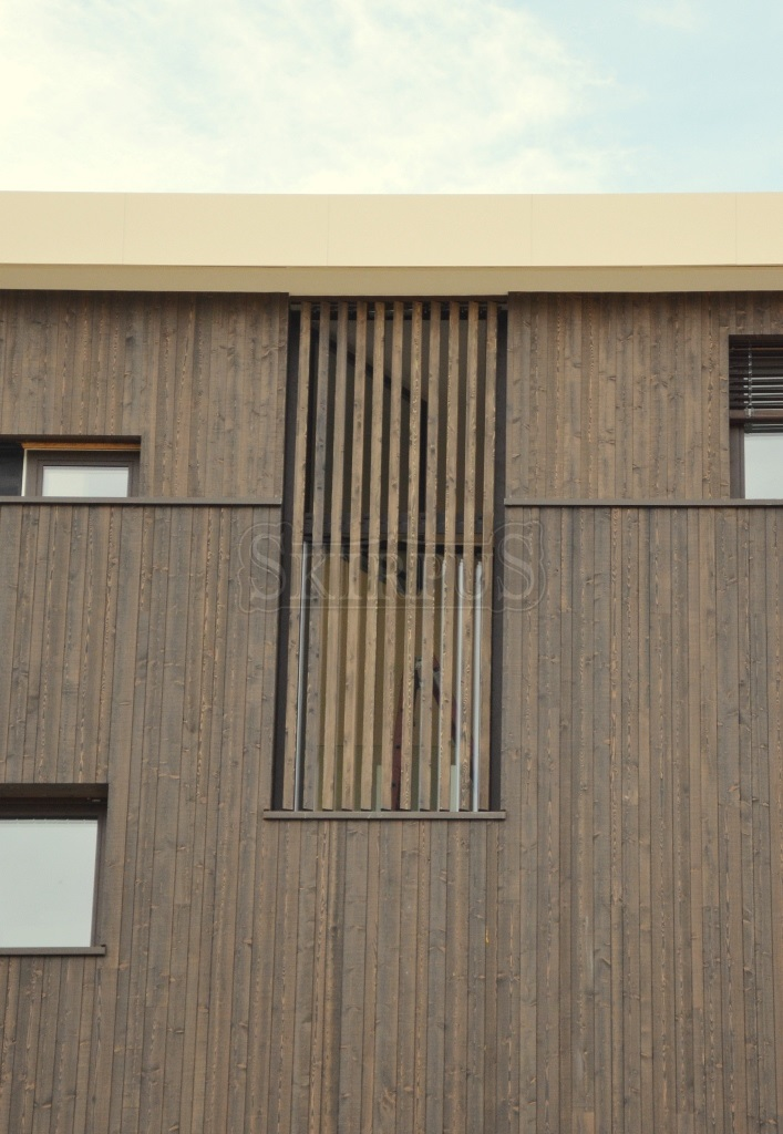 Wooden facade louvers skirpus wooden blinds and shutters for Movable exterior walls